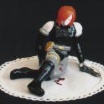 """""""Regina with gun"""" 2003, maiolica dipinta a freddo e cotone ricamato, cm. 17x17x10,5"""