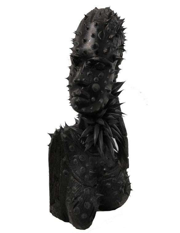 """""""Maschera contaminata"""" 2014, legno e silicone, h. cm. 28"""